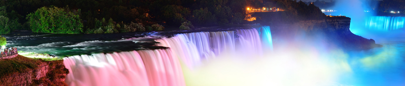 View an image of niagara falls in lights that resemble neon lights containing xenon gas.